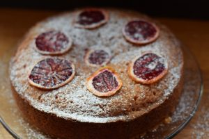 Blood orange drizzle cake with dust of sugar